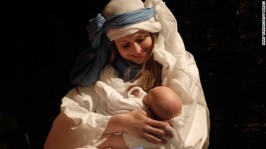 LONDON, ENGLAND - DECEMBER 19: Actor Rachel Burdon as Mary with baby Eilidh Colvin as Jesus, from the Winterhall Players, perform in The Nativity, at All Souls Church, near the BBC Broadcasting House on December 19, 2013 in London, England. This is the first year in 22 years that the company has performed the Nativity away from their home estate in Surrey, where they regularly dramatise biblical plays. The cast includes professional actors, volunteers, live animals and a choir to tell the story. (Photo by Mary Turner/Getty Images)